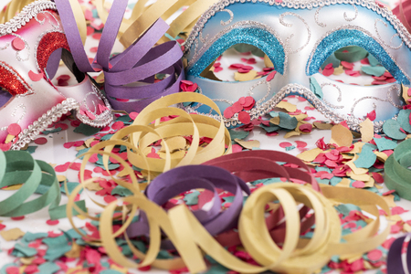 carnival venetian masks with confetti and serpentine streamers.