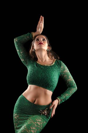 Exotic young belly dancer isolated on a black background. Standard-Bild - 130844432