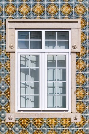 View of the typical beautiful architecture on buildings of portuguese cities, like this window with azulejo tiles. Stock fotó