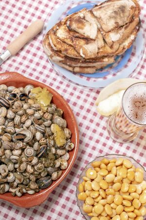 Traditional Portuguese dish of cooked snails and toasted bread and beer.