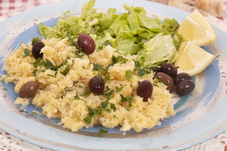 View of bacalhau a bras dish, typical Portuguese cuisine, a dish with salt cod, potatoes and eggs.