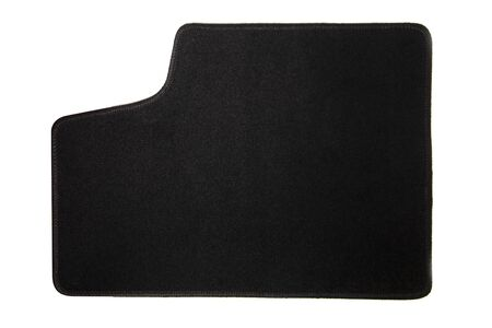 View of black car mat isolated on a white background.