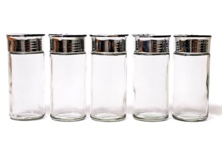 empty spice jars isolated on a white background.