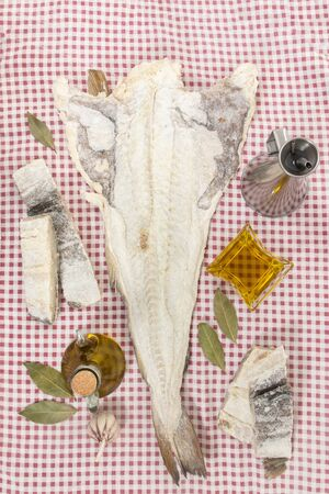 Close up view of a portuguese salted codfish on a table cloth.