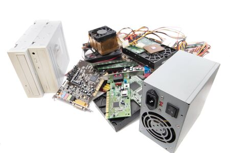Close up view of various computer parts on a white background.