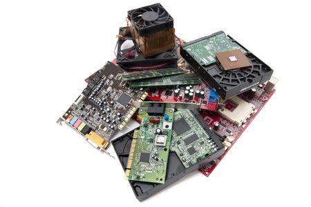 Close up view of various computer parts on a white background. 免版税图像