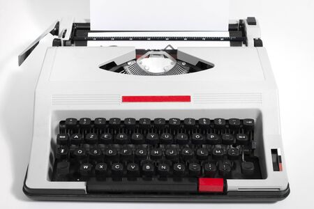 Vintage portable typewriter isolated on a white background.