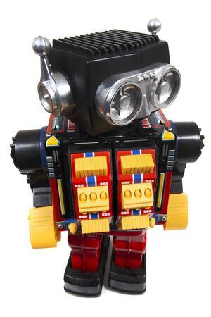 Weinlesezinn-Roboterspielzeug lokalisiert auf einem weißen Hintergrund. Standard-Bild
