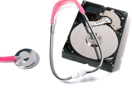 Close up view of a computer hard drive with pink stethoscope concept isolated on a white background. Reklamní fotografie