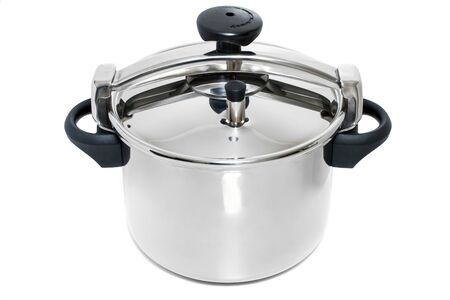 Close up view of a stainless steel pressure cooking pan isolated on a white background.