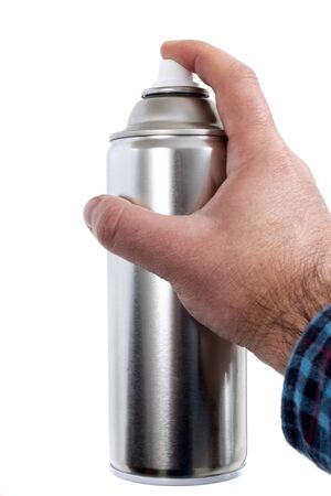 Close up view of a hand with spray can on a white background.