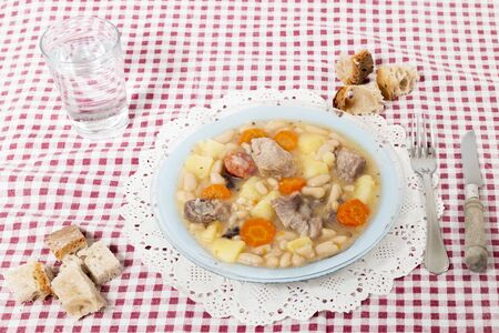 Traditional portuguese dish of a stew with white beans and carrot.