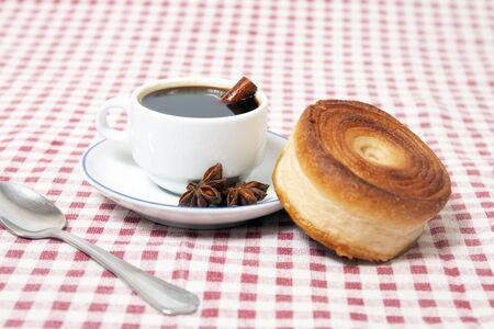 Rolled honey pastries with coffee, typical of Olhao city, Portugal. 写真素材