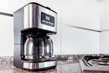 Close up view of a silver home coffee machine.