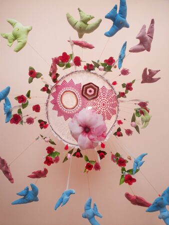 View of a beautiful colorful dream catcher on a ceiling. 스톡 콘텐츠 - 125331517