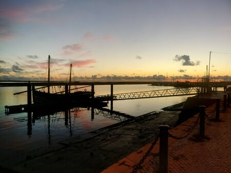 Bautiful view of anchored boat on olhao city docks at sunset. 写真素材