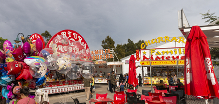 FARO, PORTUGAL - OCTOBER  2018: Fun fair event Santa Iria with games, street food, ferry wheels, bumper cars and many diverse activities. Editorial