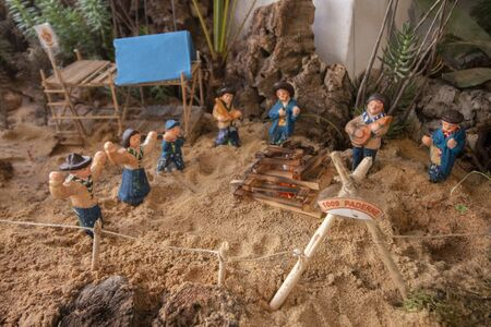 Close up view of many tiny figurines creating a large nativity scene recreation. Banco de Imagens