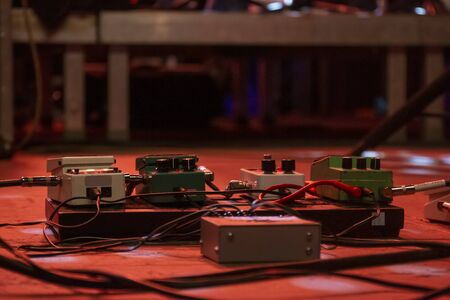 Several guitar pedals for processing different audio effects on a concert. Editorial
