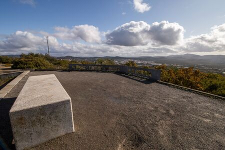 Viewpoint of Arroteia located on Sao Bras de Alportel, Portugal. Phrase says: Between land and sea. Stok Fotoğraf
