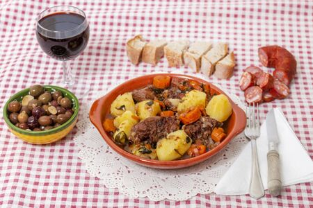 Traditional rustic meal of ox tail with potato and carrot of the Alentejo region, Portugal.