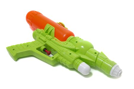 Colorful plastic water gun isolated on a white background. Stock Photo
