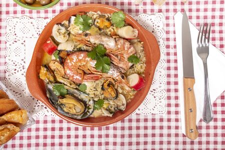 Traditional homemade meal of rice with fresh seafood of the Algarve region, Portugal.