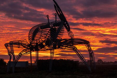 FARO, PORTUGAL: 8th DECEMBER 2019 - Crab statue in the natural marshlands at sunset located in Ria Formosa, Algarve, Portugal.