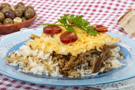 Traditional portuguese food of rice with duck and chorizo.