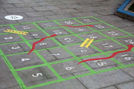 classic children game with numbers painted on the school playground floor. Standard-Bild