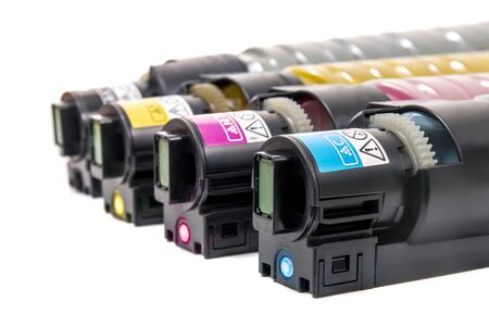 cartridges for laser printers aligned on a white background. Stock Photo