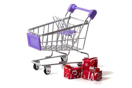 Miniature shopping cart isolated on white background.