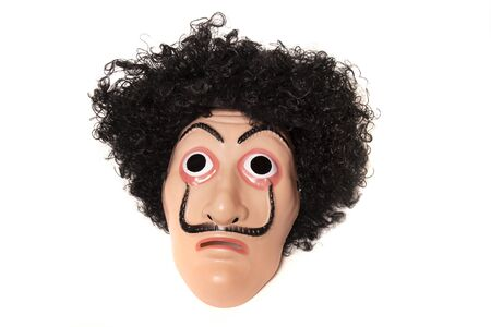 plastic costume face mask with wig isolated on a white background.