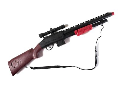 plastic shotgun toy isolated on a white background.