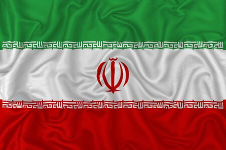 Iran country flag on wavy silk textile fabric background.