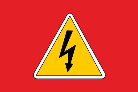 View of a high voltage sign on red background.
