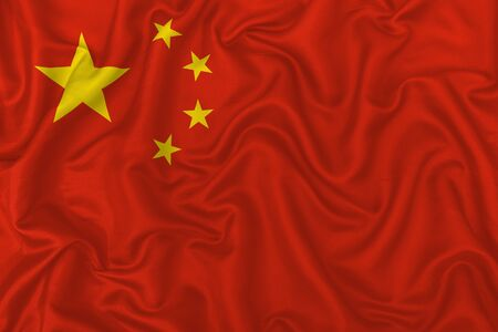 China country flag on wavy silk textile fabric background.