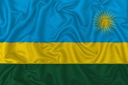 Rwanda country flag on wavy silk textile fabric background.
