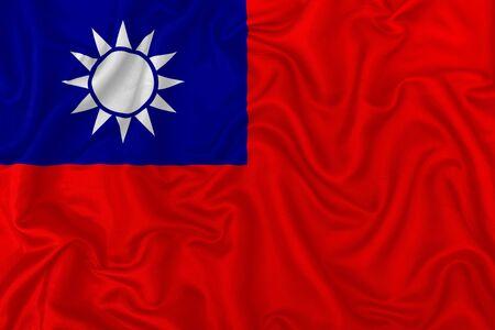 Republic of China flag on wavy silk textile fabric background.