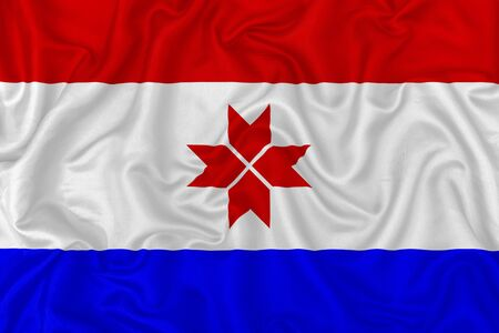 Republic of Mordovia flag on wavy silk textile fabric background.