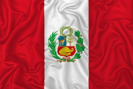 Peru country flag on wavy silk textile fabric background.