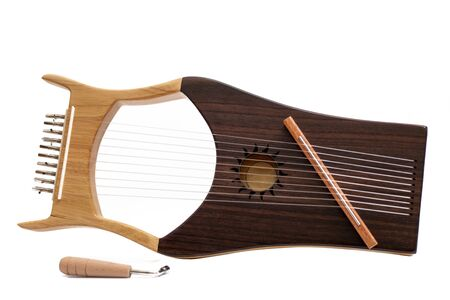 stringed lyre musical instrument isolated on a white background.