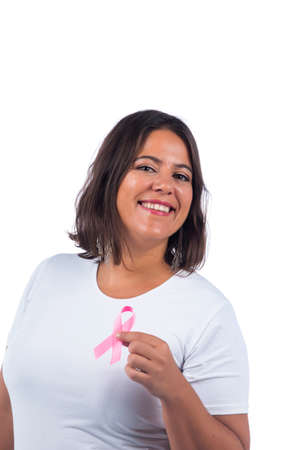 Caucasian girl holding cancer ribbon over a white background smiling.