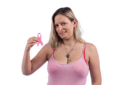 Caucasian girl with pink shirt holding cancer ribbon over a white background.