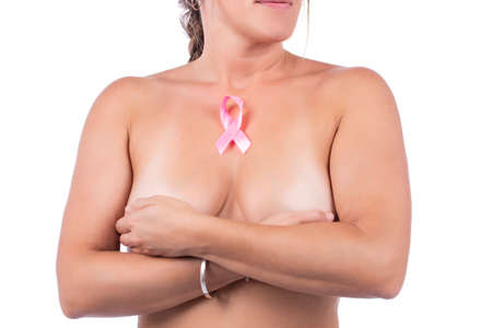 woman Breast self care and examination for lumps or weird symptoms. with a pink awareness ribbon for cancer. Zdjęcie Seryjne