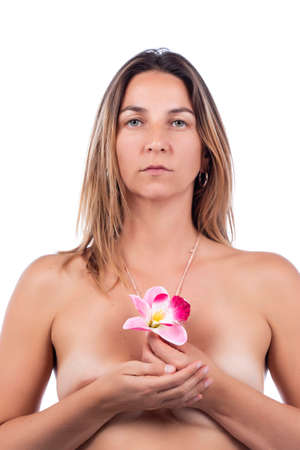 woman holding pink flowers on a elegant way on a white background. Imagens
