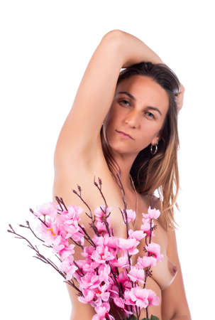 woman holding pink flowers on a elegant way on a white background.