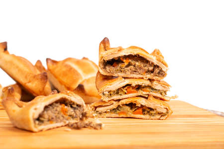 Typical appetiser savory pastries of stuffed meat and other ingredients sold on most Portuguese coffee shops and restaurants.