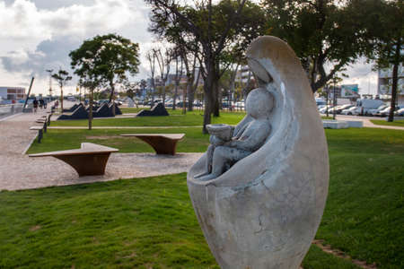 Beautiful view of the relaxing Park Patrao Joaquim Lopes statue on Olhao city, Portugal.