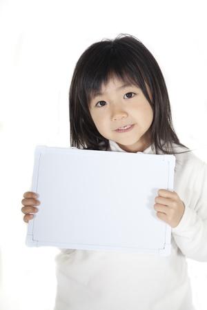 Girl having a message board Stock Photo - 13092014